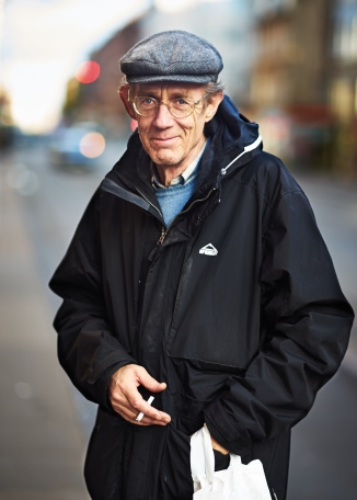 I met this elderly gentleman outside a departmental store. As he was about to pass by my side, I stopped him and told him about my project. In a deep baritone he acknowledged my blabbering about the project and while I was doing that, lit a cigarette for himself. I asked him if I could take a picture of his and he looked at me with his deep blue eyes and said alright go ahead. I was delighted - I placed him where the light was right and took a frame. I walked up to him and showed him the frame - I acknowledged it with a smile and just walked away - even before I could take down his name.