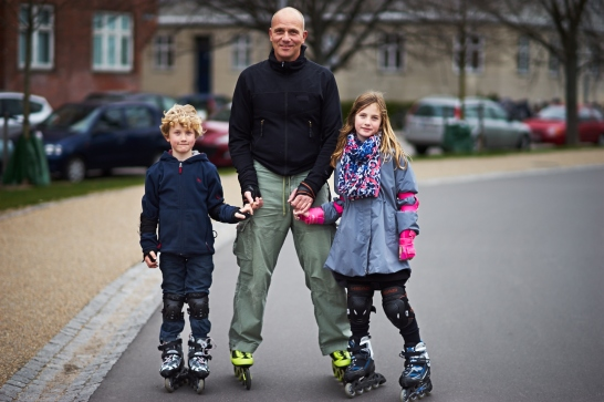I saw this lovely family of a Dad and his two kids in the park on roller blades. I asked Mr. Bjorn if I could take a picture of his, after telling him about my project. He agreed, and then its struck me, my project is all about people - so why can't it be about families. I told him I could include his kids as well. He asked kids if they would like their pictures taken. Both of them seemed excited and I asked them to pose for me. I took Mr Bjorn's email address promising him to send him this family photograph. Another milestone - the first family portrait in my project!
