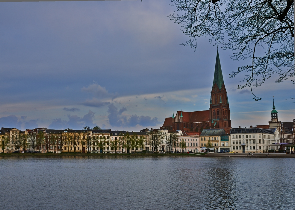 A view from across the lake as the sun set over the horizon with the church rising majestically over the town...